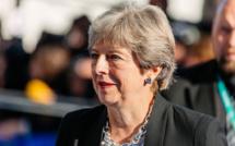 Theresa May gives up